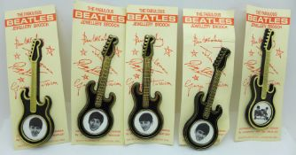 A set of five The Beatles guitar brooches