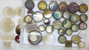 A collection of paste stones, faux pearl beads and gemstones