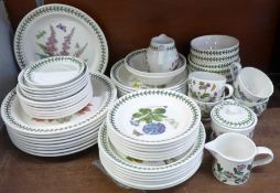 A collection of Portmeirion dinnerwares, nine dinner plates (three decorated), seven side plates,