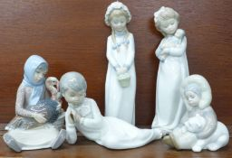 Two Lladro figures, Eskimo with polar bear cub and Girl holding a turkey plus three other Spanish