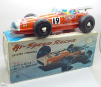 A 1960's tin-plate Japanese racing car, Hi-Speed Racer, 30cm, scratch on the bonnet, boxed