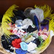 A collection of vintage millinery flowers, ostrich feathers, sequin appliques, etc.