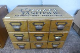 An oak table top nine drawer index filing cabinet, bearing Coats Sanitised inscription