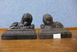 A pair of small Victorian cast iron figures of recumbent lions