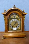 A George III style burr walnut and gilt metal bracket clock, 44cms h