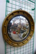 A Regency style gilt framed convex mirror
