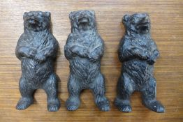 Three small Victorian cast iron figures of bears