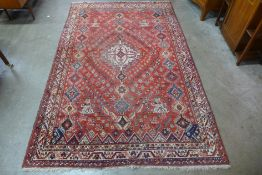 An eastern red ground geometric patterned rug, 253 x 163cms