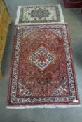 An eastern red ground geometric pattern rug, 155 x 109cms and another small cream ground rug