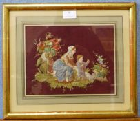 A Victorian silkwork embroidery of mother and child, 20 x 26cms, framed
