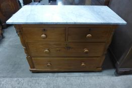 A Victorian pine and marble topped chest of drawers
