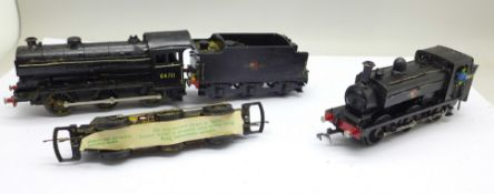 A model locomotive and tender, one other model locomotive and a part model loco
