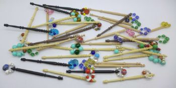 Thirty-five lace bobbins