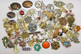 A collection of over eighty costume brooches