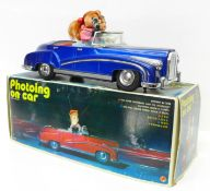 A Chinese battery operated 'Photoing on Car' mystery action tin plate car, 30cm, boxed