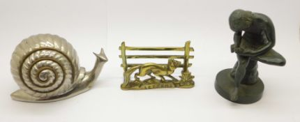 A bronze figure of a girl, a brass letter rack and a metal model of a snail