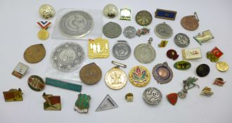 A collection of badges and medallions