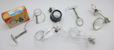 Six magnifying lenses for attaching to spectacles