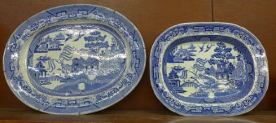 Two blue and white willow pattern serving plates, 45.5cm and 55.5cm