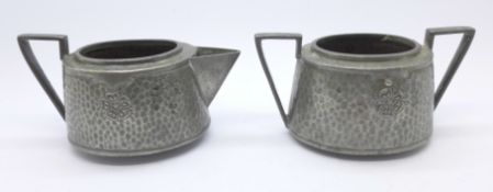 An Arts and Crafts Ashberry pewter sugar bowl and cream jug