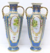 A pair of Noritake vases with gilded decoration and painted panels over a blue ground, 30.5cm