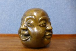 A small oriental bronze four faced Buddha, 12cms h
