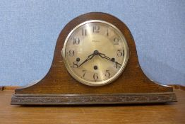 An oak mantel clock, 23cms h