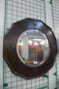 An early 20th Century oak framed dodecagon mirror, 64 x 64cms