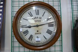 An oak wall clock, bearing Tara St. Station, Dublin inscription to dial, 41cms d