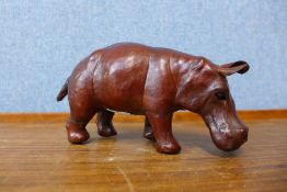A small brown leather hippopotamus, 9cms h