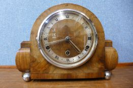 A walnut and chrome mantel clock, 22cms h