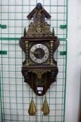 A Dutch mahogany and brass wall clock, 64cms h
