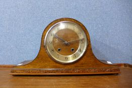 An oak mantel clock, 22cms h