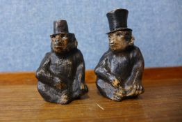 A pair of Austrian cold painted bronze monkey salt and pepperettes, 6.5cms h (one lacking top)