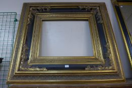 A large Victorian style ebonised and parcel gilt picture frame, 104 x 114cms