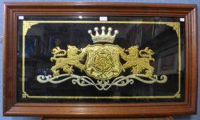 An armorial wall plaque