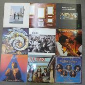 Twelve LP records, Pink Floyd, ELP, Barclay James Harvest, The Moody Blues, Police, UB40, etc.
