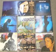 A collection of LP records, Glen Campbell, Johnny Cash, Don Williams and John Denver