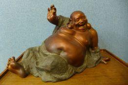 An oriental bronze figure of a seated Buddha, 36cms h