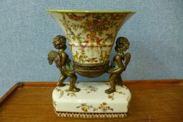 A French style gilt metal and porcelain centrepiece, 26cms h