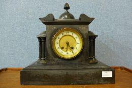 A 19th Century French Belge noir mantel clock, 34cms h