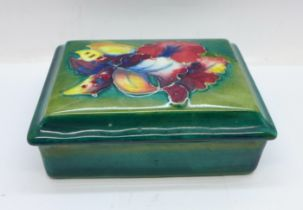 A Moorcroft trinket box and cover, signed W Moorcroft to the base and lid, 12cm x 9cm