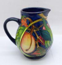 A Moorcroft Queens Choice jug, 12cm