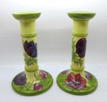 A pair of Moorcroft Anemone candlesticks, 21cm