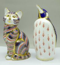 Two Royal Crown Derby paperweights, penguin and cat with silver stopper