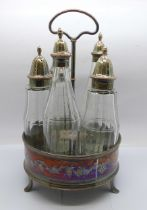 A George III five bottle cruet on a plated stand