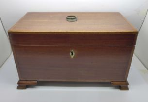 A George III inlaid mahogany tea caddy with fitted hinged compartments, lacking centre jar, 30 x