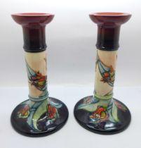A pair of Moorcroft Tulip candlesticks, 21cm