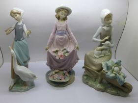 Three Lladro figures; Girl feeding a goose, Flower Curtsey and Girl with lamb and wheelbarrow