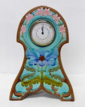 An Art Nouveau style ceramic clock, 29.5cm, movement requires mounting